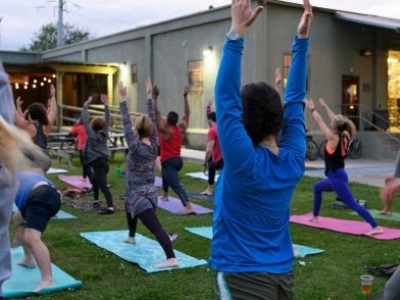 YOGA ON THE LAWN AT THE TIN ROOF BREWING COMPANY